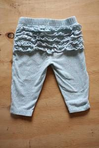 Light Green with white flower Pants with signs of was and Wear